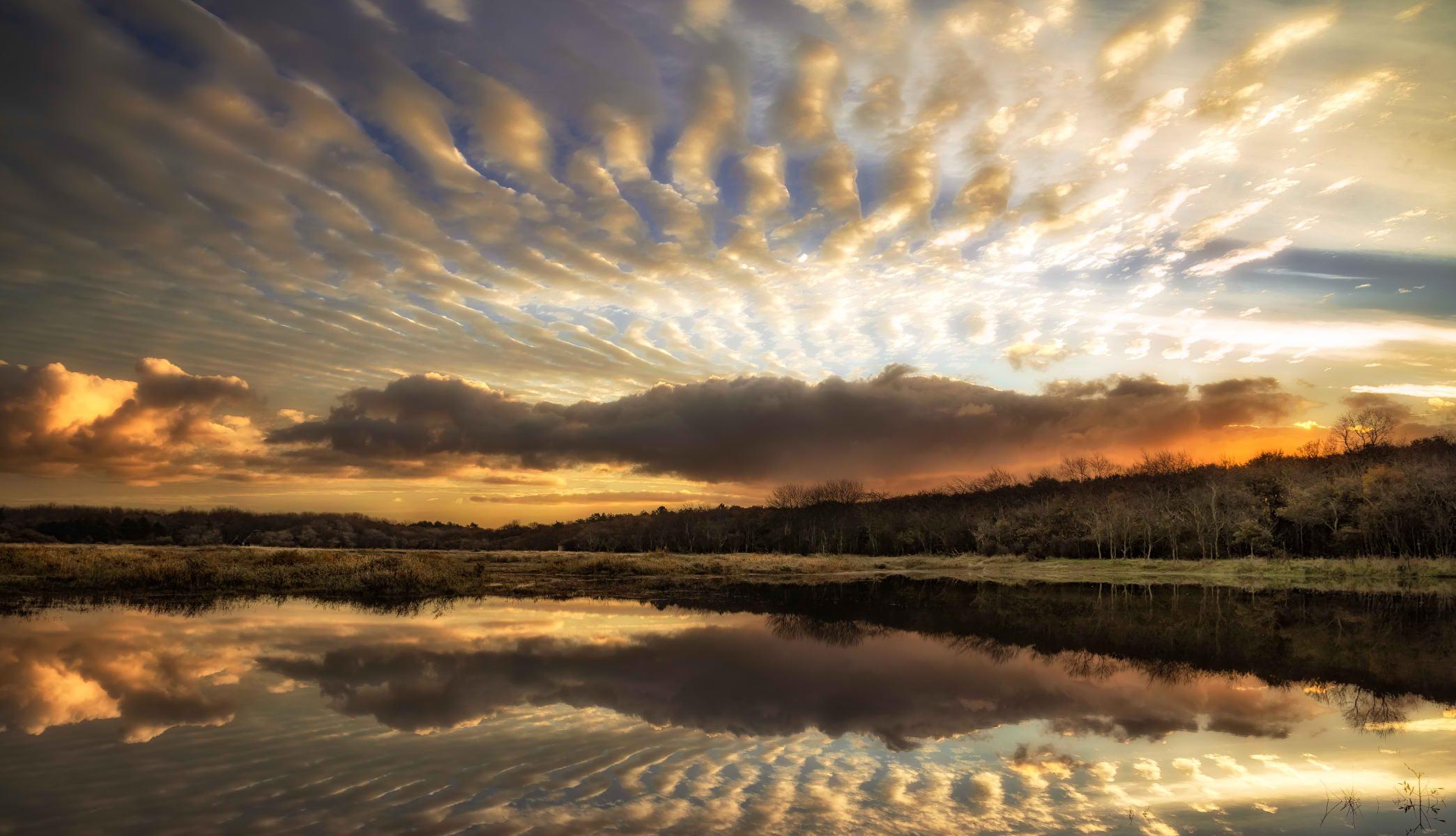 undulating clouds at dawn